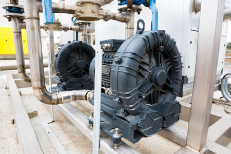returned: Electrical motor in wastewater treatment plant. Wastewater treatment is a process used to convert dirty wastewater into an effluent that can be either returned to the water cycle with minimal environmental issues or reused. Stock Photo