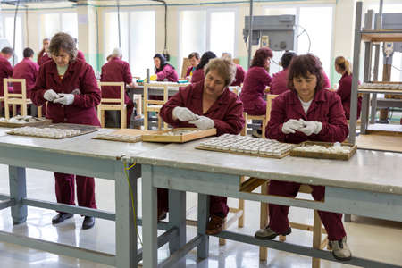 rpg: Sopot, Bulgaria - May 17, 2016: Arsenal women workers are producing weapons detonators in one of Bulgarias arms factory. The facility produces and assembles rocket-propelled grenades (RPG), RPG-7 launchers, RPG war heads, detonators, land mines and other Editorial