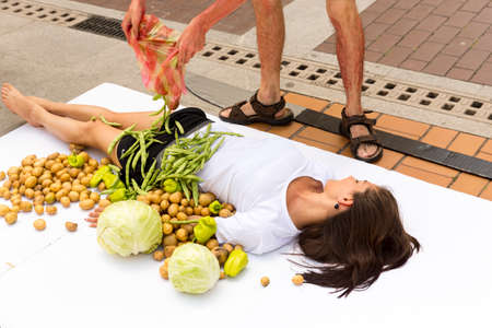 activists: Sofia, Bulgaria - June 21, 2016: Vegans and vegetarians animal rights activists are cooking humans during a protes against killing animals for meat or clothing.