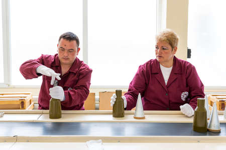 warheads: Sopot, Bulgaria - May 17, 2016: Arsenal workers are producing warheads in one of Bulgarias arms factory. The facility produces and assembles rocket-propelled grenades (RPG), RPG-7 launchers, RPG war heads, detonators, land mines and others.