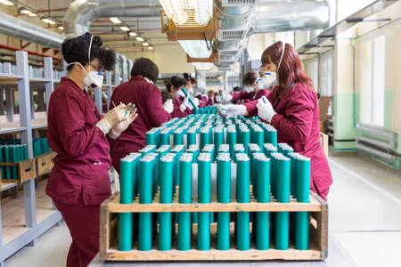 rpg: Sopot, Bulgaria - May 17, 2016: Arsenal women workers are producing weapons in one of Bulgarias arms factory. The facility produces and assembles rocket-propelled grenades (RPG), RPG-7 launchers, RPG war heads, detonators, land mines and others. Editorial