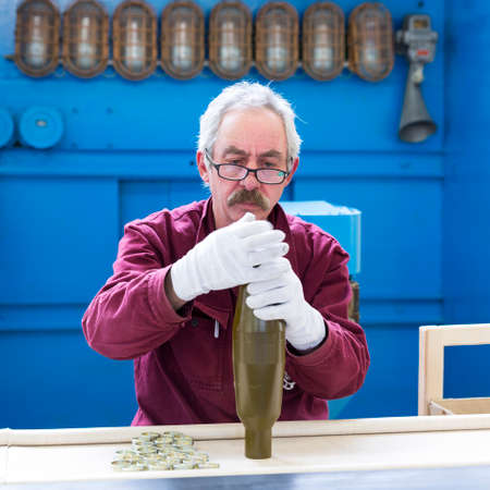 Sopot, Bulgaria - May 17, 2016: Arsenal worker is producing warheads in one of Bulgarias arms factory. The facility produces and assembles rocket-propelled grenades (RPG), RPG-7 launchers, RPG war heads, detonators, land mines and others.