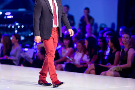 red pants: A male model walks the runway during the AutumnWinter Sofia Fashion Week Show 2016 in Sofia, Bulgaria. red pants Editorial
