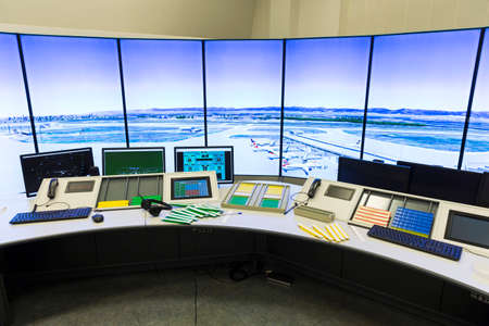 Bullgaria's Air Traffic Services Authority control center room. Controller's desk near control computer monitors. No people. Standard-Bild