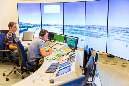 Sofia, Bulgaria - September 12, 2016: An air traffic controller is directing flights during a working day at Bullgarias Air Traffic Services Authority control center room. Talking with the pilot. Editorial