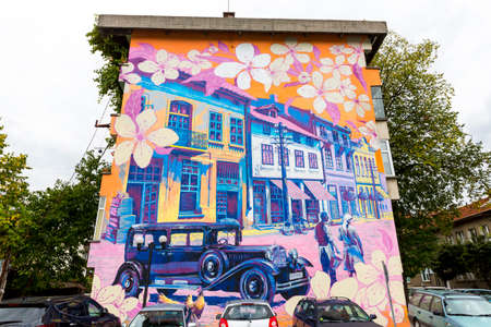 troyan: Troyan, Bulgaria - October 5, 2016: A street art painting illustrating the old town of Troyan. A painting on a building made by artists Damyan Bumbalov and Hristo Hristov.