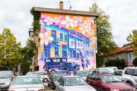 illustrating: Troyan, Bulgaria - October 5, 2016: A street art painting illustrating the old town of Troyan. A painting on a building made by artists Damyan Bumbalov and Hristo Hristov.