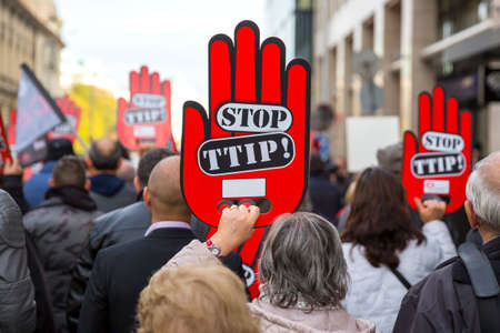 Activists are holding red hand signs Stop TTIP during a demonstration against Free Trade Agreements TTIP, CETA and TISA between EU and U.S. in Sofia, Bulgaria. Editorial