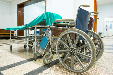 Wheelchair in a hospital corridor for physically disabled patients. No people. Healthcare equipment.
