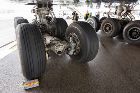 Sofia, Bulgaria - October 16, 2016: Lufthansa Airbus A380 airplane at Sofia's airport. Airport workers in front of the airplane's tires.