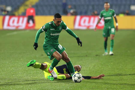 palomino: Sofia, Bulgaria - November 1, 2016: Arsenals Defender Shkodran Mustafi challenges Palomino Natanael during UEFA Champions League football match between Ludogorets Razgrad and Arsenal at Bulgarias National Stadium. Editorial