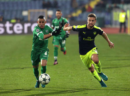 Sofia, Bulgaria - November 1, 2016: Arsenals Defender Shkodran Mustafi challenges Palomino Natanael during UEFA Champions League football match between Ludogorets Razgrad and Arsenal at Bulgarias National Stadium. Editorial