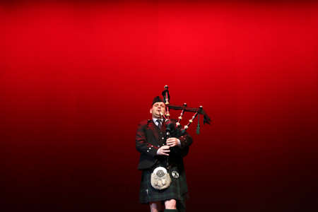 bagpipe: Sofia, Bulgaria - November 9, 2016: Scottish bagpipe performer from ensemble Bulgare is playing his pipes during a performance. Editorial
