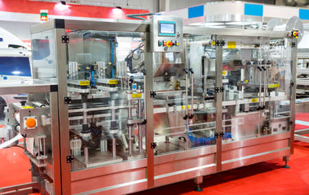 food plant: Packing machine is shown at a food and drink exhibition. Stock Photo