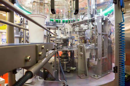 Yoghurt packing machine is shown at a food and drink exhibition. Standard-Bild