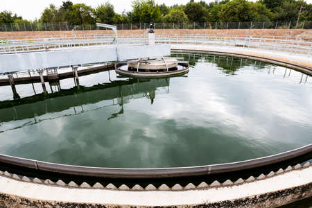 Modern urban wastewater treatment plant. Water cleaning facility outdoors. Water purification is the process of removing undesirable chemicals, suspended solids and gases from contaminated water. Stok Fotoğraf - 67026297