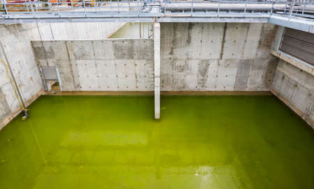 contaminated: Modern urban wastewater treatment plant. Water cleaning facility outdoors. Water purification is the process of removing undesirable chemicals, suspended solids and gases from contaminated water.