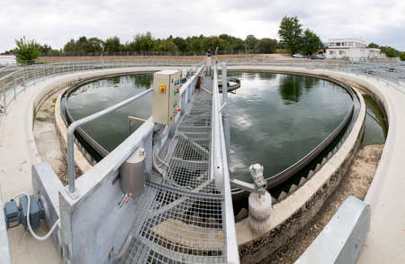 turbidity: Modern urban wastewater treatment plant. Water cleaning facility outdoors. Water purification is the process of removing undesirable chemicals, suspended solids and gases from contaminated water.