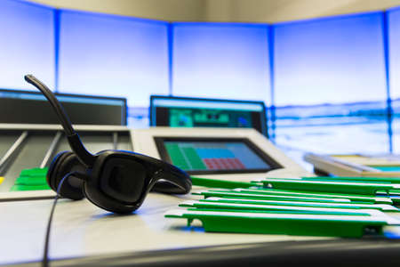 air traffic: Air traffic controllers at work in the flight control tower at Sofias airport. Headset. Air traffic control directs aircraft on the ground and through controlled airspace.