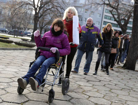 Sofia, Bulgaria - December 7, 2016: Physically and mentally disabled are accompanied by their parents, relatives and friends at a protest against policies against them. Editorial