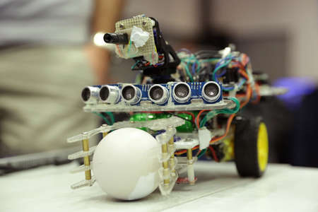 Sofia, Bulgaria - December 17, 2016: A race robot during an open competition of self-made robots among school students. A robot with ping pong ball. 新闻类图片