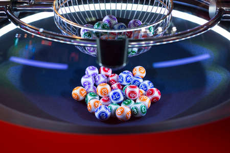 bets: Colourful lottery balls in a rotating bingo machine.
