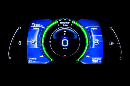 Modern light car mileage (dashboard, milage) isolated on a black background. Mileage of a electric car with batteries. New display of a modern car. Total power.