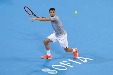 Sofia, Bulgaria - February 9, 2017: Grigor Dimitrov (pictured) from Bulgaria plays against Jerzy Janowicz from Poland during a match from Sofia Open 2017 tennis tournament.