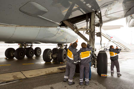 Sofia, Bulgaria - October 16, 2016: Workers check Airbus' A380 airplane's tires at Sofia's airport.