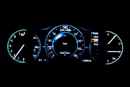 Modern light car mileage (dashboard, milage) isolated on a black background. New display of a modern car. RPM, Fuel indicator and temperature. Sport. 25 mph. Stock Photo