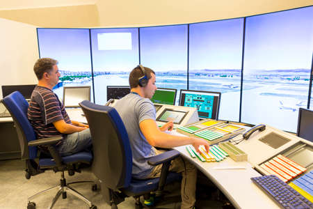 Sofia, Bulgaria - September 12, 2016: A controller in Bulgarian Air Traffic Services Authority's surveillance control room is navigating airplanes of Sofia's airport.