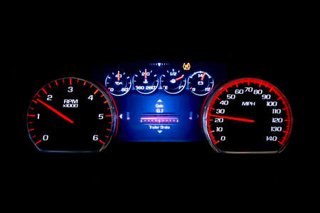Modern light car mileage (dashboard, milage) isolated on a black background. New display of a modern car. Gain.