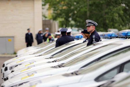 lightbar: Sofia, Bulgaria - 12 May 2017: Police officers stand beside their new patrol cars in the Ministry of the Interior during a ceremony showing the new vehicles. Surveillance and audio recording vehicles.