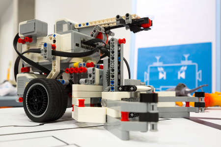 A remote control robot made from building blocks assembled by children.