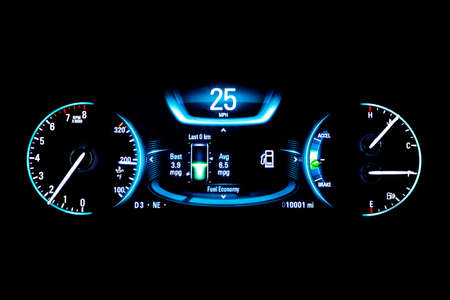kilometres: Modern light car mileage (dashboard, milage) isolated on a black background. New display of a modern car. RPM, Fuel indicator and temperature. Fuel economy. 25 mph.