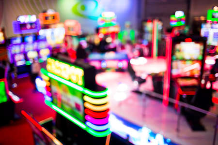 Out of focus (defocused) slot machines are seen from above in a casino room. Stok Fotoğraf