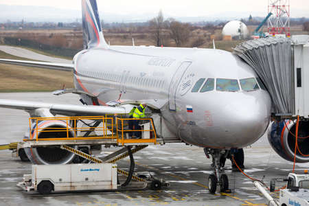 Sofia, Bulgaria - 8 March, 2017: Airport workers load Russian airplane before flight at Sofia International Airport.