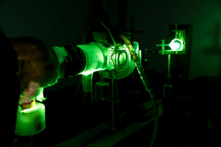 Powerful industrial green laser equipment in a laboratory for physics research. Solid State Physics lab. Light amplification by stimulated emission of radiation (LASER).
