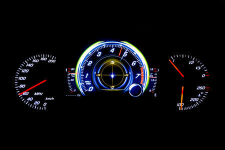 Modern light car mileage (dashboard, milage) isolated on a black background. New display of a modern car. MPH, fuel and temperature (Fahrenheit) digital indicators.