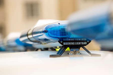 lightbar: Blue warning lightbars on new patrol police cars. Close-up.