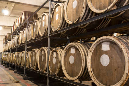 Scotch Whisky Barrel rows. Whiskey and brandy distillery. Oak barrel used to age whiskey. Stok Fotoğraf - 87774296