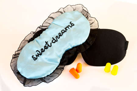 Sleeping masks isolated on a white background. Sweet dreams blue and black. Studio shot.