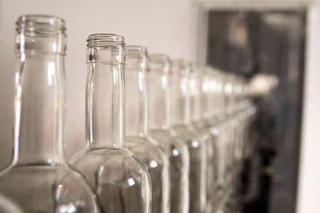 Whiskey whiskey and brandy distillery. Empty glass bottles. Stock Photo