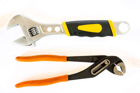 Adjustable pliers and Wrench isolated on a white background. Studio shot