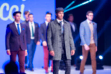 Blurry out of focus (defocus) Male models walk the runway during the AutumnWinter Sofia Fashion Week Show 2016 in Sofia, Bulgaria.