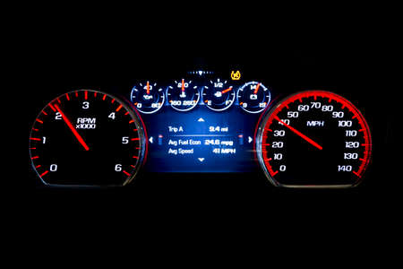 Modern light car mileage (dashboard, milage) isolated on a black background. New display of a modern car. Avg fuel econ, Avr speed. 免版税图像