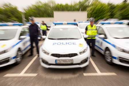 lightbar: Police officers stand beside their new patrol cars in the Ministry of the Interior during a ceremony showing the new vehicles. Surveillance and audio recording vehicles. Stock Photo