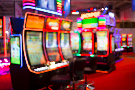 Blurred slot machines are seen in a casino. Out of focus blurry image of casino equipment.