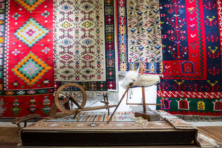 Weaving equipment for Chiprovtsi Carpets. Traditional colorful carpets from Chiprovtsi region in Bulgaria. Hand-woven (hand-made) carpets with different elements and colours. Ethnic and folk patterns.