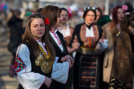 Pernik, Bulgaria - 28 January 2018: Participants take part in the International Festival of Masquerade Games Surva. The festival promotes variations of ancient Bulgarian and foreign customs and masks. Folk costumes.